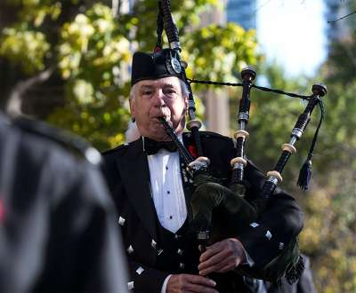 A bagpiper plays at the annual Service of Remembrance