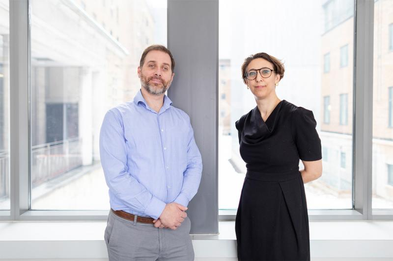 Robert Kozak and Samira Mubareka stand before a sunny window.