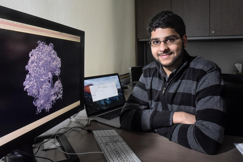 Ali Punjani looks up from his computer screen, which displays an image of an intricate irregular mass.
