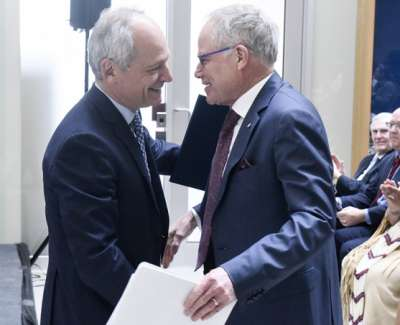 U of T President Meric Gertler greets Bruce Kidd (photo by Ken Jones)