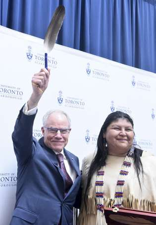 U of T Scarborough Traditional Elder Wendy Phillips presented Bruce Kidd with an Eagle feather