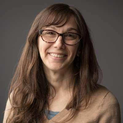 Portrait of Chelsea Rochman smiling.