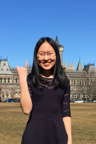 Maddie Zhang holds up her little finger showing her engineer's steel ring.