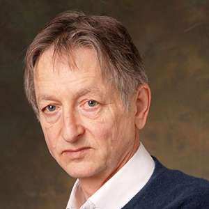 Portrait of Geoffrey Hinton looking serious.