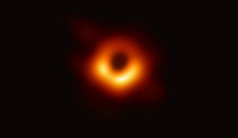 The black hole looks like a dark circle surrounded by a glowing donut of light, brighter on one side.  (photo courtesy of U.S. National Science Foundation)