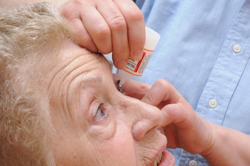 A nurse in France administers an anti-glaucoma agent to a patient (photo by BSIP/UIG via Getty Images)