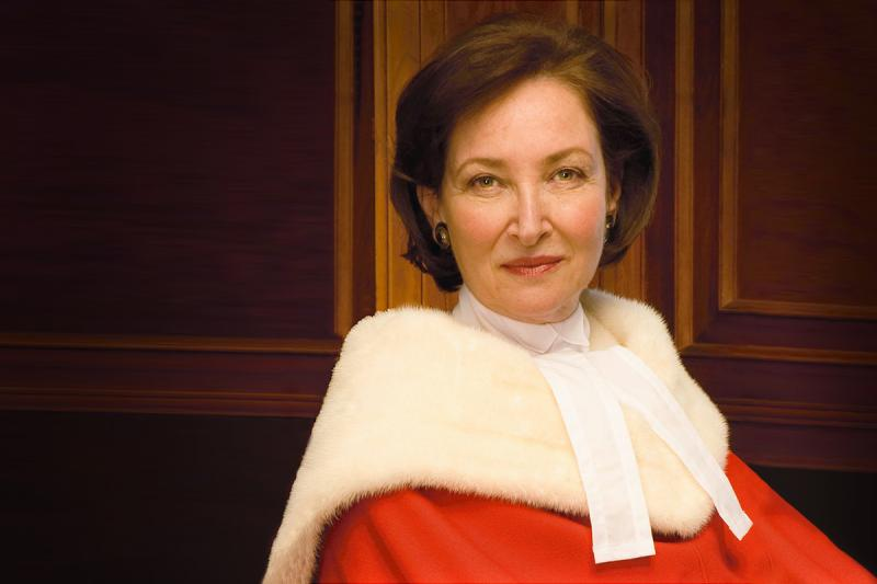 Rosalie Abella smiles while wearing her Supreme Court of Canada robes.