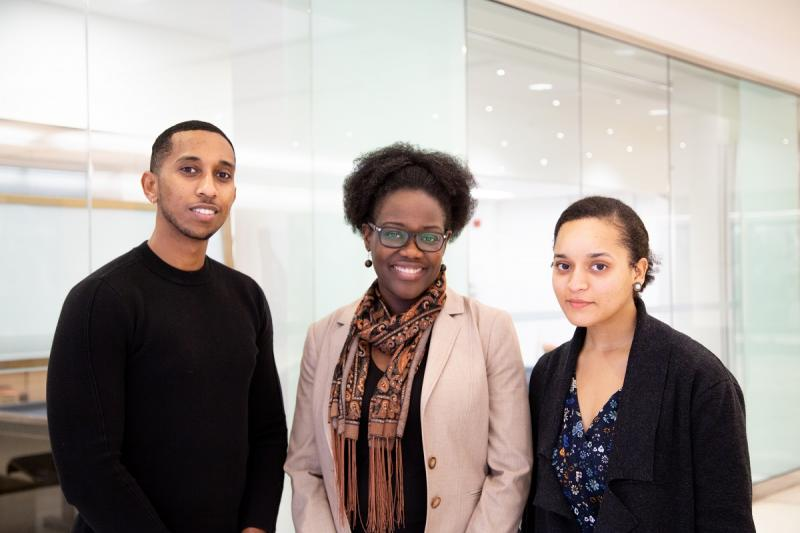 U of T medical students Semir Bulle (left) and Chantal Phillips (right) with Dr. Onye Nnorom, MD Black health lead of the MD program (photo by Julia Soudat)
