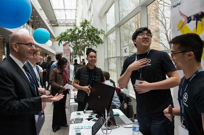 Steven Del Duca, Ontario's minister of economic development and growth, visits StageKeep's table at last week's U of T Startup Showcase (photo by Laura Pedersen)