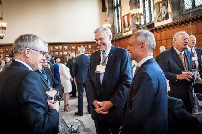 Wilson greeted guests at the May tribute, including leaders from U of T such as Bruce Kidd (left), vice-president of U of T and principal of U of T Scarborough (photo by Lisa Sakulensky)