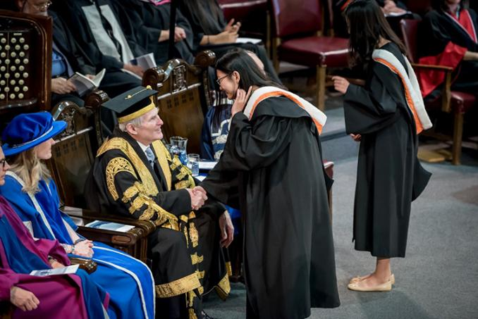 Wilson greets graduating students at Thursday's convocation of Rotman Commerce (photo by Steve Frost)
