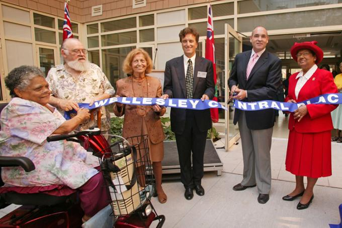 Peter Rekai (centre) cuts the ribbon with current residents and board member at the opening of Wellesley Central Place in 2005 (photo courtesy of the Rekai Centres)
