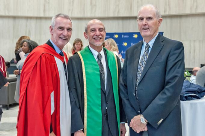 Robert McNutt (right) with Ulrich Krull (centre), vice-president and principal of U of T Mississauga, at Krull's installation. Ian Orchard, the former principal, is at left.