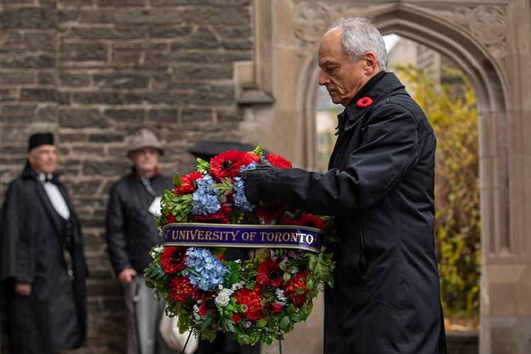 U of T President Meric Gertler lays a wreath at the foot of Soldiers' Tower (photo by Nick Iwanyshyn)