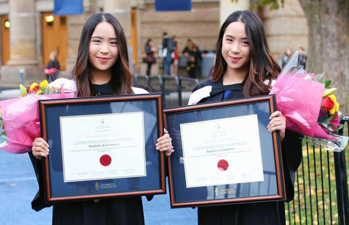 Madeleine and Samantha Caleon at their convocation in November: The sisters earned Bachelor of Commerce degrees at U of T Mississauga (photo courtesy of the twins)
