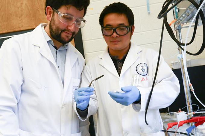 Pelayo Garcia De Arquer (left) and Cao Thang Dinh (right) examine a wafer coated in their new catalyst (photo by Tyler Irving)