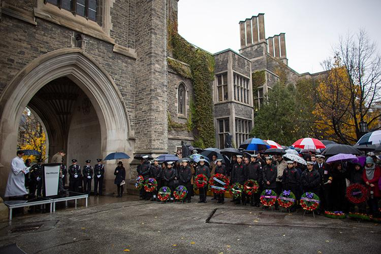 A large crowd braves the wind and rain during a service of remembrance on U of T's downtown Toronto campus (photo by Nick Iwanyshyn)