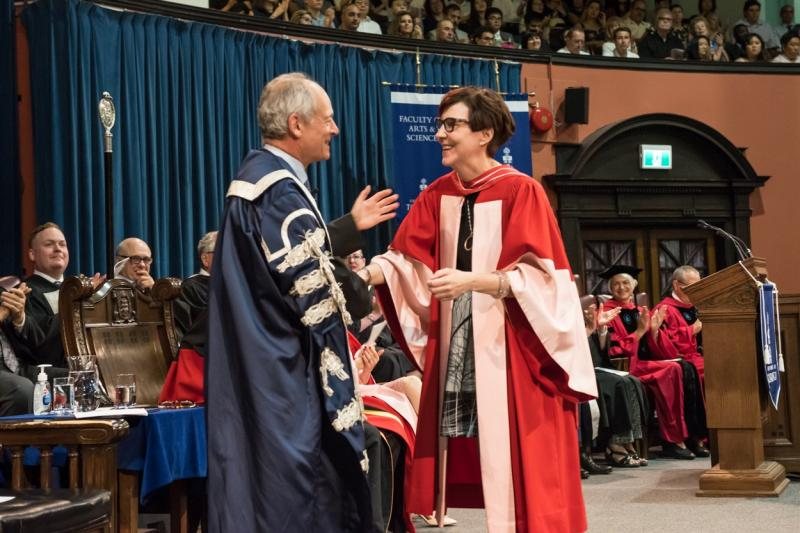 Cindy Blackstock, who has been named an Officer of the Order of Canada, shakes hands with U of T President Meric Gertler while accepting an honorary degree in June (photo by Lisa Sakulensky)