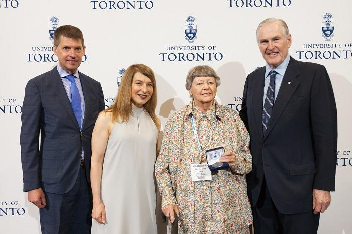 Five time U of T graduate Dr. Dormer Ellis celebrating her special anniversaries with Tye Farrow, Barbara Dick and Chancellor Michael Wilson. Photo by Gustavo Toledo.