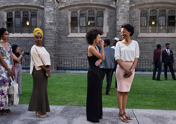 Students line up before making a grand entrance at the second student-led Black graduation ceremony in June at Hart House. In 2017, U of T became the first Canadian university to host a Black graduation (photo by Geoffrey Vendeville)