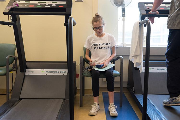 Elspeth Arbow, an undergraduate student with cystic fibrosis recovering from her second double-lung transplant, gets ready for physiotherapy at Toronto General Hospital on May 4 (photo by Geoffrey Vendeville)