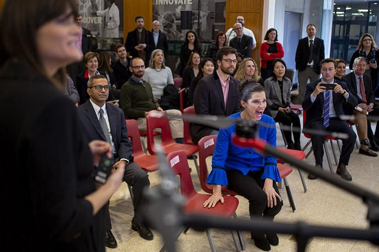 Kirsty Duncan, minister of science and sport, watches a demonstration during a Nov. 13  announcement about new and renewed chairs in the Canada Research Chairs program, including 21 at U of T  (photo by Nick Iwanyshyn)