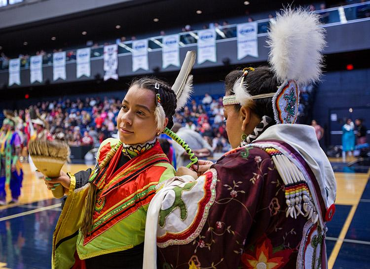 Hundreds of people in a rainbow of colours filled the Goldring Centre for High Performance Sport at the University of Toronto for the Indigenous Studies Students' Union's powwow on March 11  (photo by Laura Pedersen)