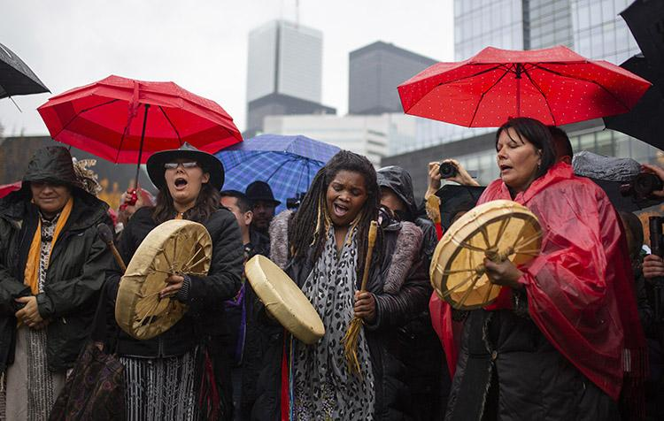 Drummers welcome delegates during a Spiritual Opening Ceremony for the Parliament of the World's Religions around the Sacred Fire in Olympic Park, on Nov. 2 (photo by Nick Iwanyshyn)
