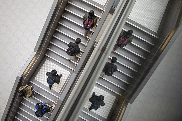 Your mind isn't playing tricks on you. Students go up the stairs at U of T Scarborough (photo by Nick Iwanyshyn)