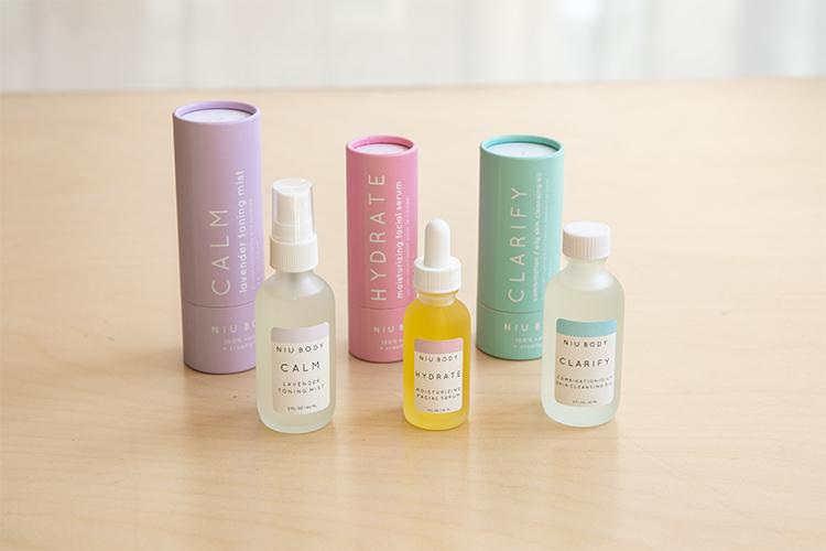 An array of cosmetics in bottles labelled: Calm, Hydrate, and Clarify.