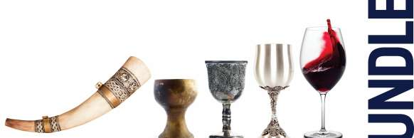 A horn wine glass, wooden goblet, pewter goblet, silver goblet, modern wine glass half-filled with red wine.