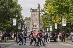 Students cross the road at the University of Toronto. Photo by Geoffrey Vendeville.
