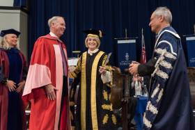 From left: William Downe, U of T Chancellor Rose Patten and President Meric Gertler at Tuesday's convocation ceremony (photo by Lisa Sakulensky)