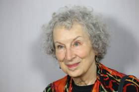 Portrait of Margaret Atwood, smiling.