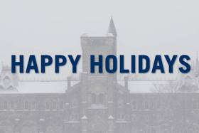 "Screenshot from President's message with snow falling and a ""Happy Holidays"" banner."