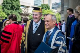 Michael Wilson and U of T President Meric Gertler at Wilson's last convocation as chancellor in June (photo by Steve Frost)