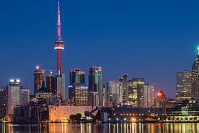 Photo of the Toronto skyline at night, including the CN Tower