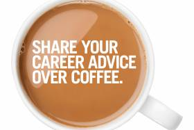 "Overhead view of a full, white mug of coffee with ""share your career advice over coffees"" written on it."