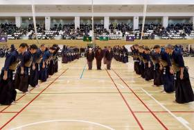 U of T alumni bow respectfully to each other before a kendo event.