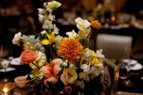 Floral arrangement of orange and white flowers.
