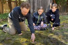 Prof. Marc Johnson and two children digging in the backyard