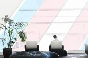 an office with large windows that are a similar colour to the transgender flag