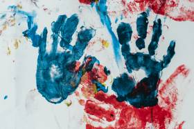 Hand prints in several colours of paint