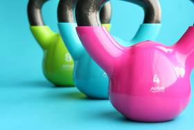 Bright close up of colourful kettle bells