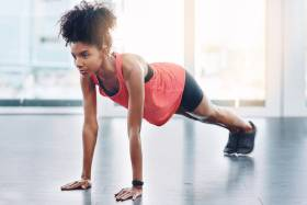 Woman holding a plank position in an exercise studio