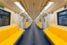 Photo of empty subway car with yellow seats