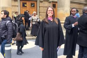 Erica Gavel smiles broadly as she stands among the swirling crowd on the steps of Convocation Hall.