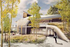 An illustration of the planned Indigenous House shows curving shapes and a green roof.