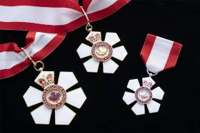 The six-petaled Order of Canada medal contains a crown, a maple leaf, and the words: Desiderantes meliorem patriam