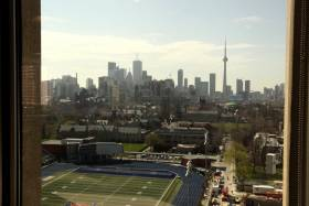 The view from a window in the OISE building looks over Varsity Stadium and downtown Toronto.